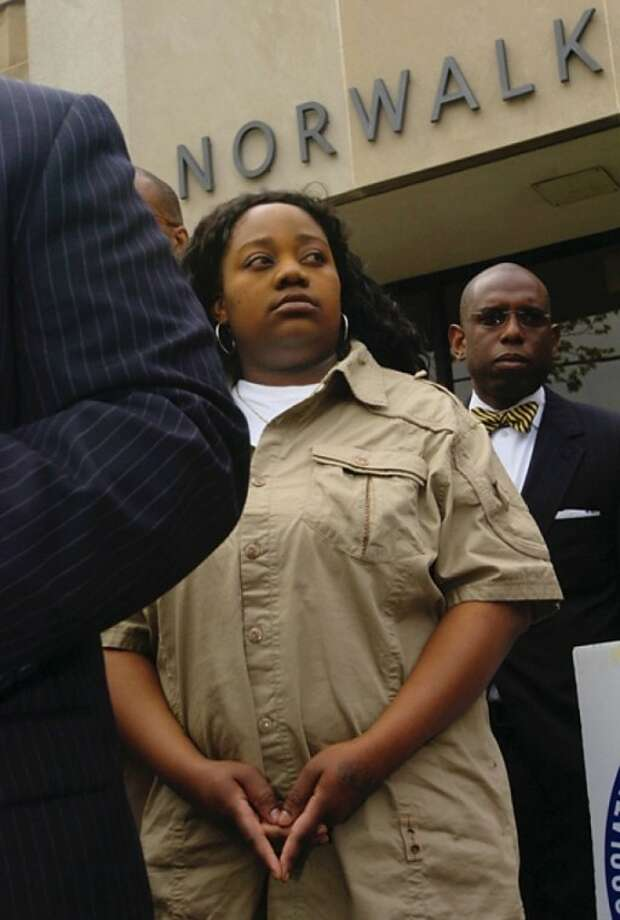 Tanya McDowell, who was arrested and charged with larceny and conspiracy to commit larceny for allegedly stealing $15,686 from Norwalk schools after she enrolled her son in the school system, attends a press conference outside Norwalk Superior Court Wednesday morning. Hour photo / Erik Trautmann