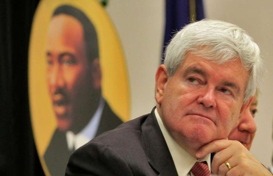 Presidential candidate Newt Gingrich, listens to speakers at the Martin Luther King Jr. celebration breakfast Monday, Jan. 16, 2012 at the Canal Street Recreation Center in Myrtle Beach. (AP Photo/The Sun News, Steve Jessmore) / ©The Sun News 2011