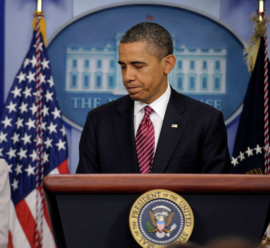 President Barack Obama concludes his remarks in the Brady Press Briefing Room of the White House in Washington, Friday, Feb. 10, 2012, where he announced the revamp of his contraception policy requiring religious institutions to fully pay for birth control. (AP Photo/Susan Walsh) / AP