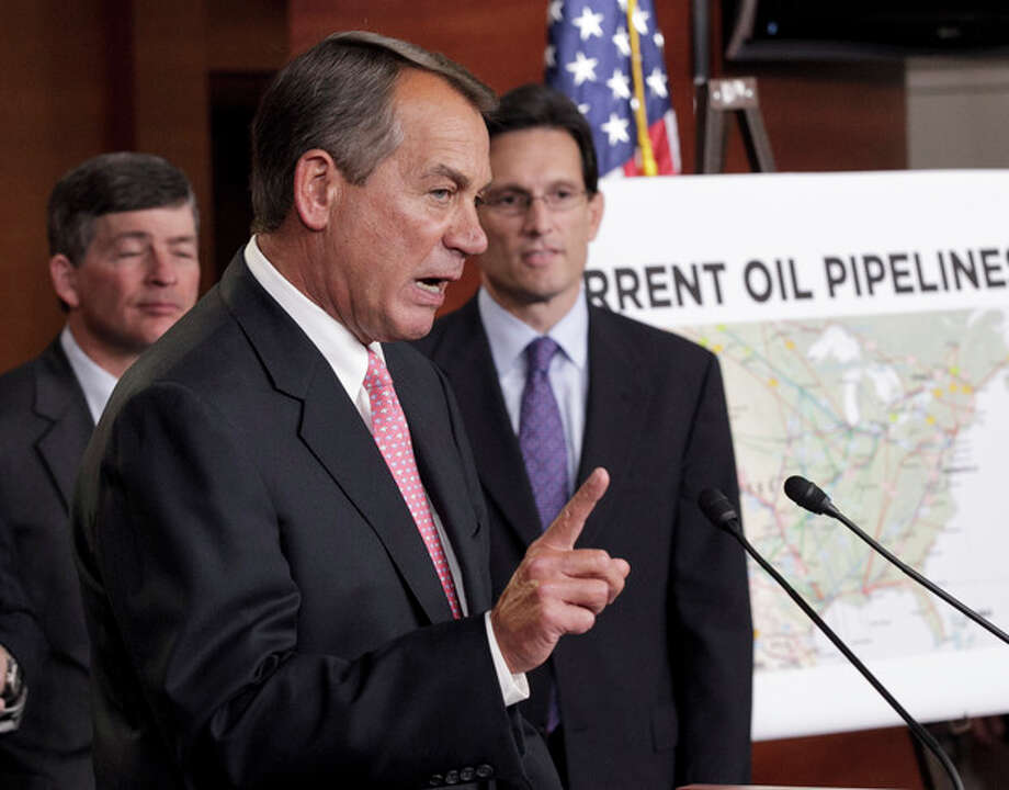 House Speaker John Boehner of Ohio, center, accompanied by House Majority Leader Eric Cantor of Va., right, and Rep. Jeb Hensarling, R-Texas, gestures during a news conference on Capitol Hill in Washington, Wednesday, Jan. 18, 2012, to discuss President Barack Obama's decision to halt the Keystone XL pipeline. (AP Photo/J. Scott Applewhite) / AP
