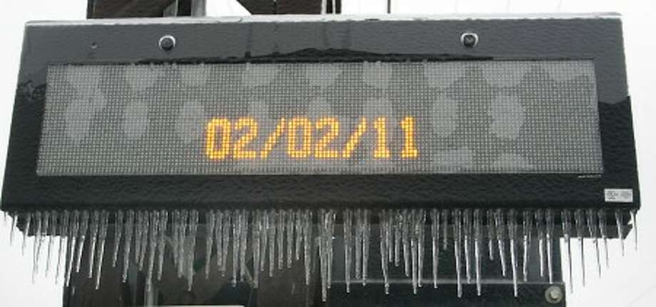 Photo by CHRIS BOSAK A sign at the Noroton Heights train station shows the day of the ice storm.