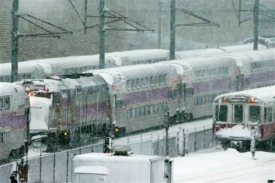 Massachusetts Bay Transportation Authority trains sit idle early Saturday, Feb. 9, 2013 in Boston due to high winds and the nearly two-feet of snow that fell in the area overnight. (AP Photo/Gene J. Puskar) / AP2013