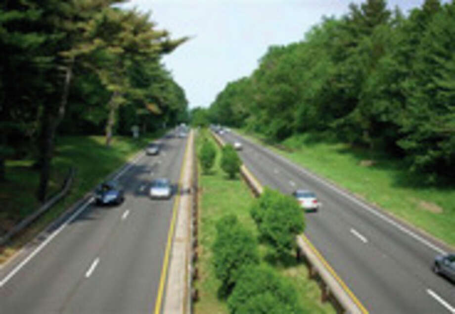 FILE - This undated file photo provided by the National Trust for Historic Preservation and released by the Merritt Parkway Conservancy, shows the Merritt Parkway, in Fairfield County, Conn. Stately trees hugging the roadside are pretty but sometimes perilous, falling onto cars three times in recent weeks, including one that killed a Massachusetts driver on June 23, 2011. (AP Photo/National Trust for Historic Preservation via Merritt Parkway Conservancy, File) / AP2008