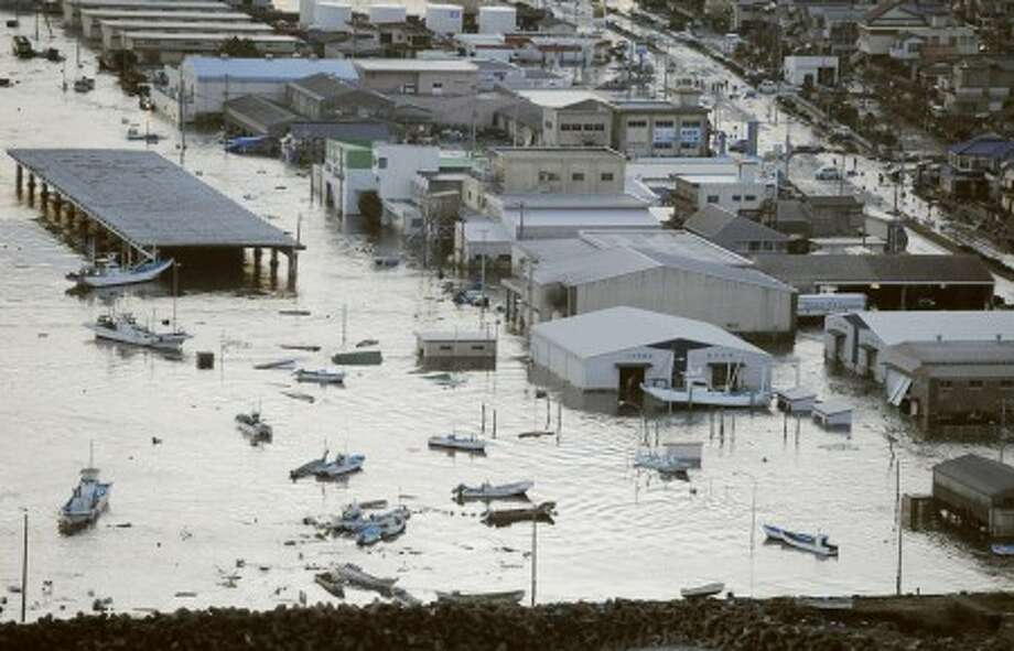 A port is submerged after a tsunami spawned by a powerful earthquake in Oarai town, Ibaraki prefecture (state), Japan, Friday, March 11, 2011. The powerful tsunami spawned by the largest earthquake in Japan''s recorded history slammed the eastern coast Friday, sweeping away boats, cars, homes and people. (AP Photo/Kyodo News) JAPAN OUT, MANDATORY CREDIT, FOR COMMERCIAL USE ONLY IN NORTH AMERICA