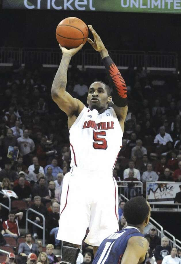 AP photo Louisville's Chris Smith shoots over UConn's Ryan Boatwright during Monday night's 80-59 win by the Cardinals.