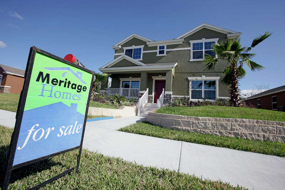 This Dec. 20, 2011 photo, shows a new home for sale in Winter Garden, Fla. U.S. home prices fell in most major cities for the second straight month, further evidence that the housing recovery will be bumpy. (AP Photo/John Raoux) / AP