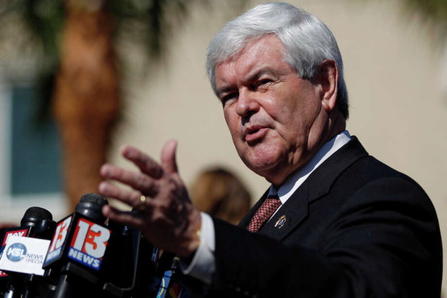 Republican presidential candidate, former House Speaker Newt Gingrich, speaks to media during a news conference outside the Exciting Idlewild Baptist Church, Sunday, Jan. 29, 2012, in Lutz, Fla. (AP Photo/Matt Rourke) / AP