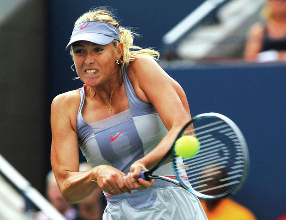 AP photo Maria Sharapova of Russia returns a shot to Heather Watson of Britain during first-round play Monday at the U.S. Open tennis tournament in New York. Sharapova won, 3-6, 7-5, 6-3. / AP