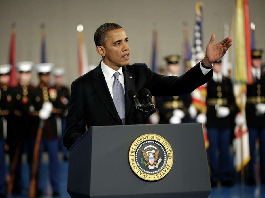 President Barack Obama gestures speaks during an Armed Forces Farewell Ceremony to honor outgoing Defense Secretary Leon Panetta, Friday, Feb. 8, 2013, at Joint Base Myer-Henderson Hall in Arlington, Va. (AP Photo/Pablo Martinez Monsivais) / AP