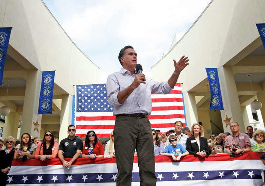 Republican presidential candidate, former Massachusetts Gov. Mitt Romney, campaigns at Sugden Plaza in Naples, Fla., Sunday, Jan. 29, 2012. (AP Photo/Charles Dharapak) / AP