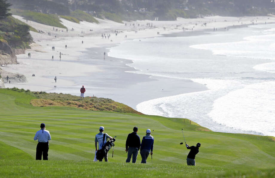 Patrick Cantlay, right, hits from the fairway down to the ninth green of the Pebble Beach Golf Links during the third round of the AT&T Pebble Beach Pro-Am golf tournament Saturday, Feb. 9, 2013, in Pebble Beach, Calif. (AP Photo/Eric Risberg) / AP