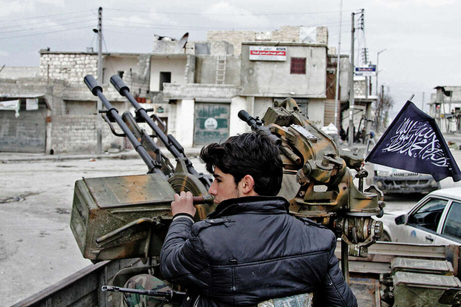 AP Photo/Abdullah al-YassinIn this Friday Feb. 8, photo, a Free Syrian Army fighter sits behind an anti-aircraft weapon in Aleppo, Syria. / AP