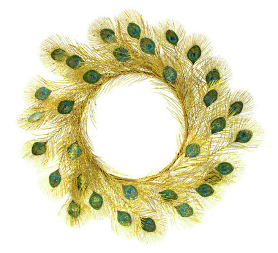 "This product image courtesy of Homegoods shows their peacock feather wreath. The holidays give us an excuse to jazz up the house with stuff we don't normally ""wear"" - essentially, it's dress-up time for our living spaces. (AP Photo/Homegoods) / Homegoods"