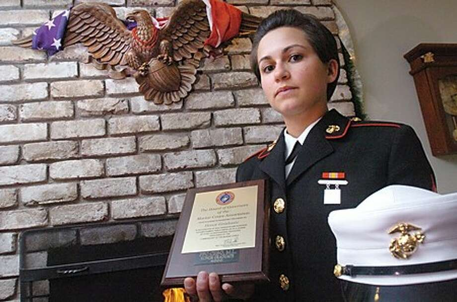 Michelle Cebo, 27, from Stamford recently completed her US Marine Corps training with the highest honors. photo/matthew vinci