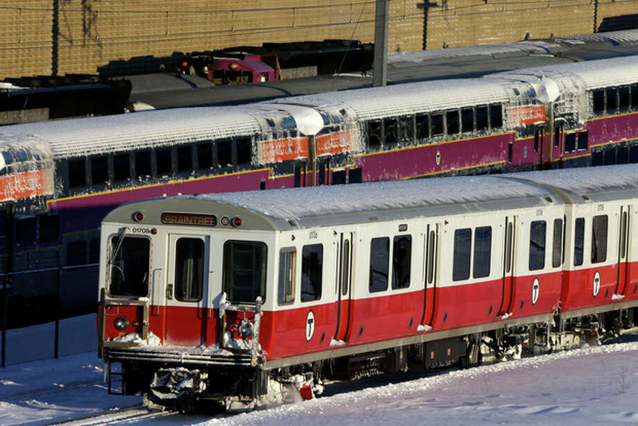 Massachusetts Bay Transportation Authority commuter trains wait to start running again early Sunday, Feb. 10, 2013 in Boston. The MBTA hopes to have commuter train service fully restored for the Monday morning rush hour. (AP Photo/Gene J. Puskar) / AP