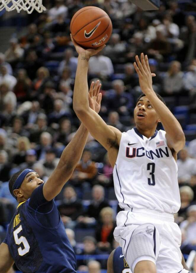 Connecticut's Jeremy Lamb (3) shoots over West Virginia's Kevin Jones (5) during the first half of an NCAA college basketball game in Hartford, Conn., on Monday, Jan. 9, 2012. (AP Photo/Fred Beckham)