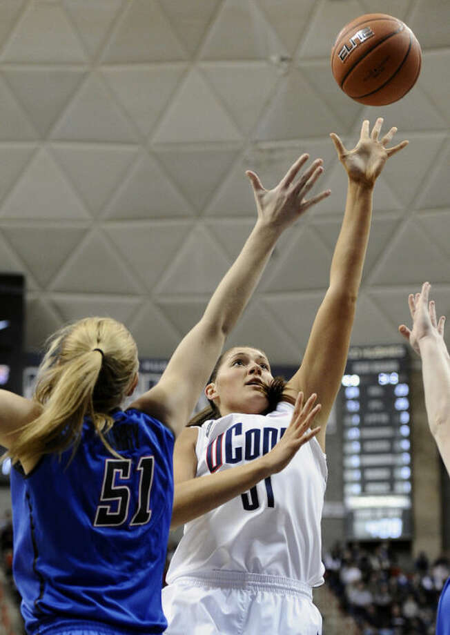 Connecticut's Stefanie Dolson, right, goes up for a basket as DePaul's Katherine Harry, left, defends during the first half of an NCAA college basketball game in Storrs, Conn., Sunday, Feb. 10, 2013. Dolson had 22 points in the first half. (AP Photo/Jessica Hill)