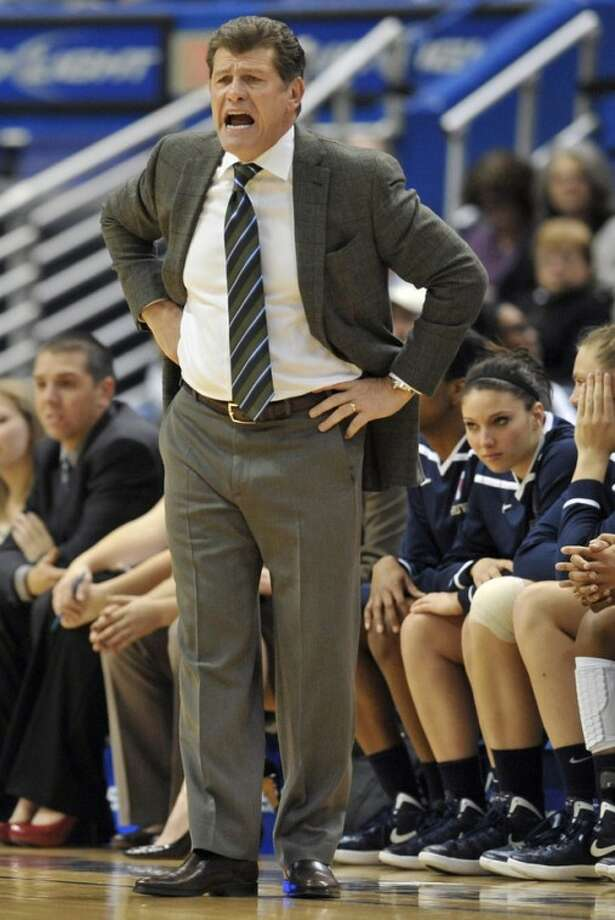 Connecticut head coach Geno Auriemma reacts in the first half of an NCAA college basketball game against West Virginia in Hartford, Conn., Wednesday, Jan. 4, 2012. (AP Photo/Jessica Hill)
