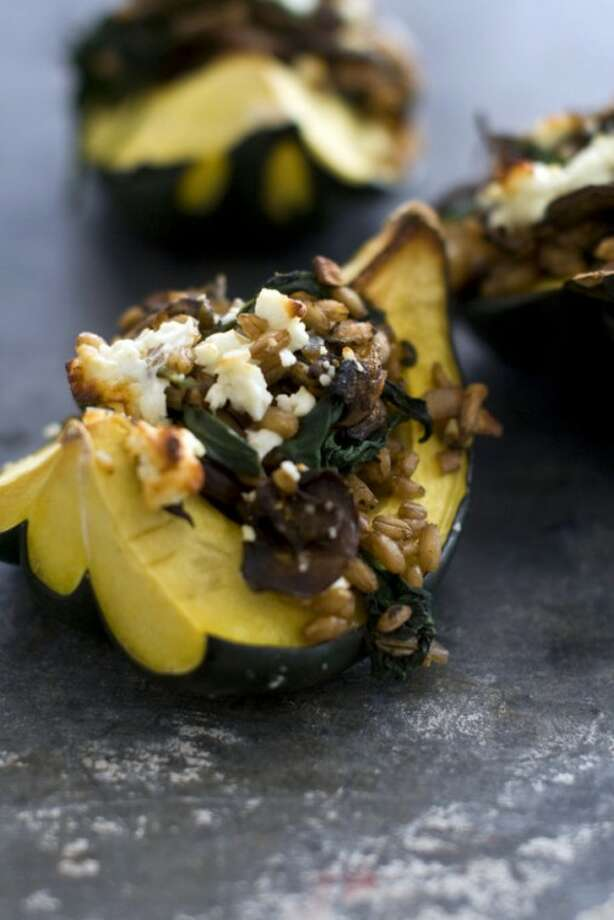 This Jan. 24, 2012 photo shows farro and mushroom stuffed acorn squash in Concord, N.H. This one-dish meal is rich in savory flavors thanks to a blend of meat, mushrooms and cheese. (AP Photo/Matthew Mead)