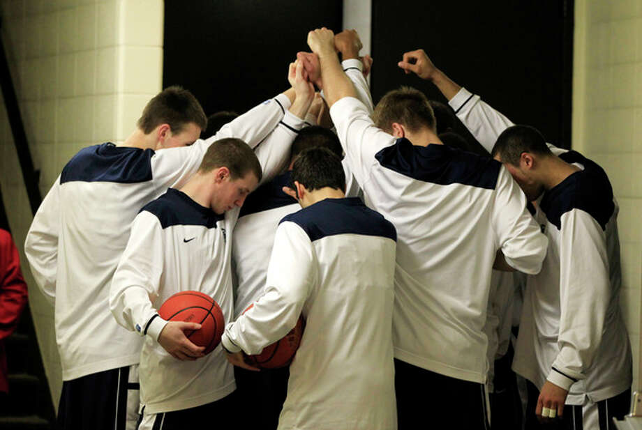 Members of the Penn State basketball team pause before going out onto the court for an NCAA college basketball game against Indiana, Sunday, Jan. 22, 2012, in Bloomington, Ind. Former Penn State football coach Joe Paterno died Sunday morning the family said in a statement. (AP Photo/Darron Cummings) / AP2012