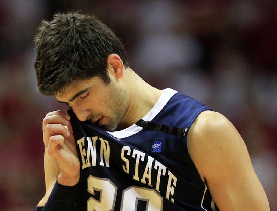 Penn State's Nick Colella wipes his face during the second half of an NCAA college basketball game against Indiana, Sunday, Jan. 22, 2012, in Bloomington, Ind. Indiana defeated Penn State 73-54. The black ribbon was in remembrance of former Penn State football coach Joe Paterno who died Sunday. (AP Photo/Darron Cummings) / AP2012