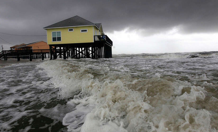 AP photo / Dave Martin Squalls and heavy surf pounds homes along the beach in Dauphin Island, Ala., Monday. The heavy waves were breaking under homes, damaging underpinnings and ripping porches and steps from the structures. Tropical Storm Lee is moving inland along the Gulf Coast bringing torrential rains and flooding. / AP