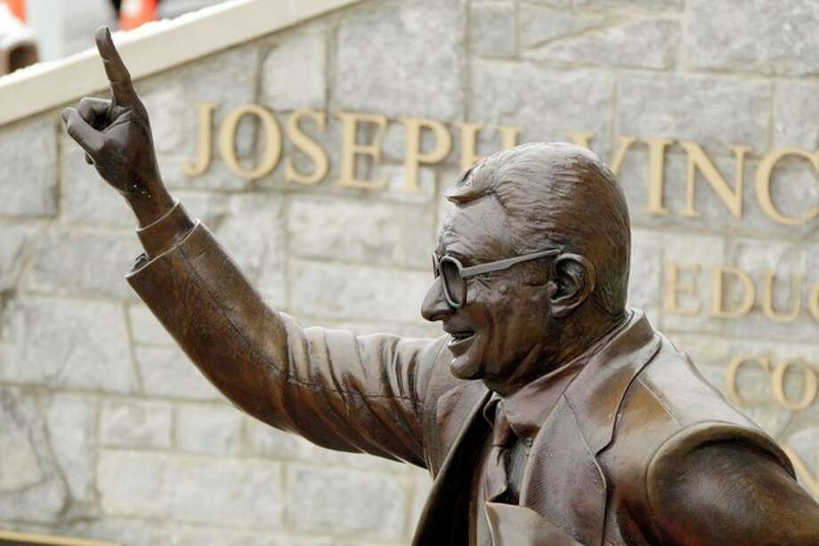 This is a statue of Joe Paterno outside Beaver Stadium on the Penn State University campus after learning of his death Sunday, Jan. 22, 2012 in State College, Pa. (AP Photo/Gene J. Puskar) / AP