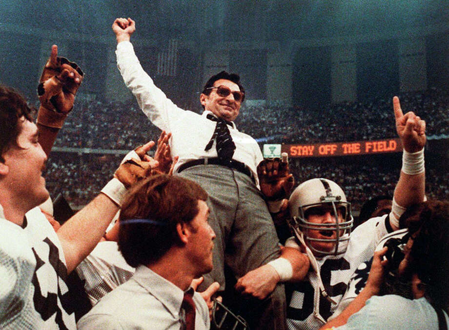 FILE - In this Jan. 1, 1983 file photo, Penn State head football coach Joe Paterno takes a victory ride from his players after defeating Georgia 27-23 in the Sugar Bowl NCAA college football game at the Supderdome in New Orleans, to win the national championship. On Sunday, Jan. 22, 2012, family says Paterno, winningest coach in major college football, has died. (AP Photo/File) / 1983 AP