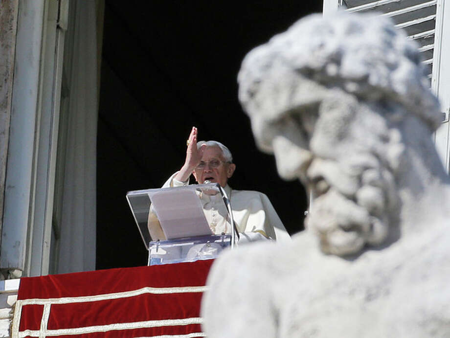 Pope Benedict XVI blesses the faithful from his studio's window overlooking St.Peter's square during the Angelus noon prayer, at the Vatican, Sunday, Feb. 10, 2013. (AP Photo/Gregorio Borgia) / AP
