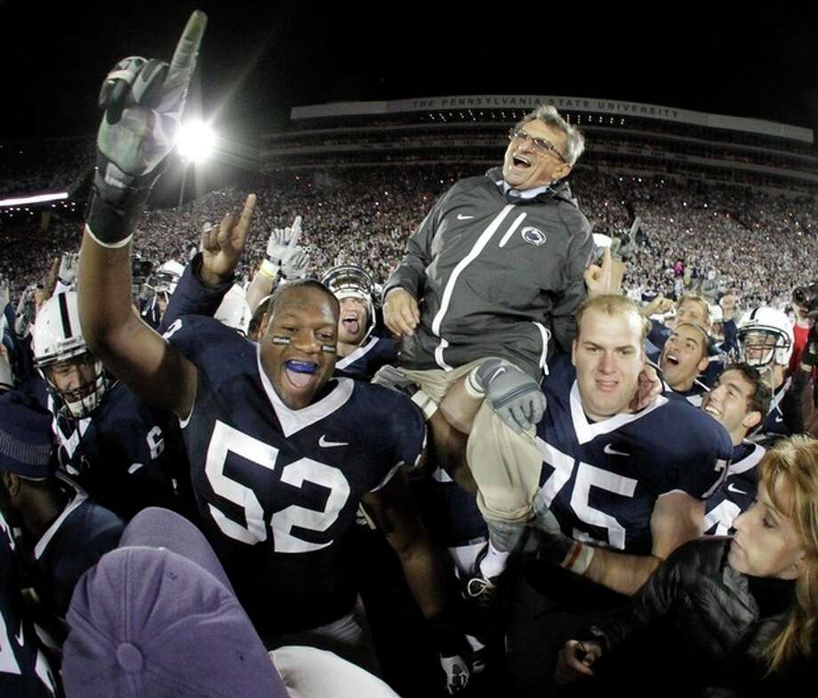 AP file photo In this Nov. 6, 2010 file photo, Penn State coach Joe Paterno is carried off the field by his players after getting his 400th collegiate win after their 38-21 victory over Northwestern in a game in State College, Pa. Paterno, the longtime Penn State coach who won more games than anyone else in major college football, died Sunday, He was 85. / AP2010