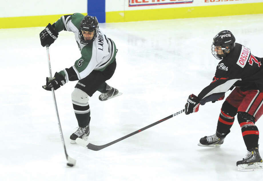 Hour photo/John NashConnecticut Oilers forward Connor Lamberti, left, gets off a shot before Springfield Pics player Austin Orszulak can defend during Wednesday's game at the SoNo Ice House. Springfield skated to a 4-2 victory.