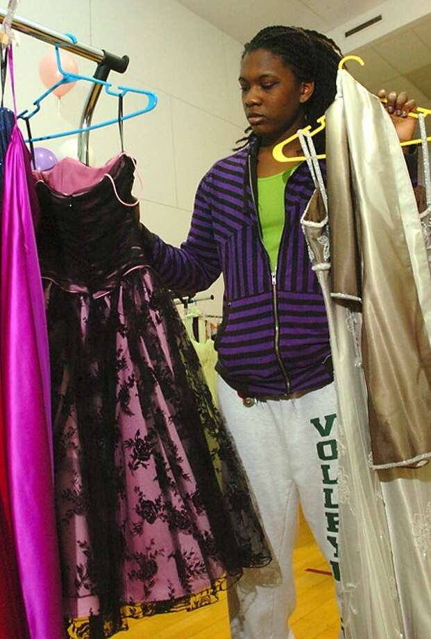 Norwalk High School senior Rottisha Lewis looks at dresses at the Christian Community Action 3rd annual Prom Dress Extravaganza at the Norwalk Y Saturday. Hour photo / Erik Trautmann