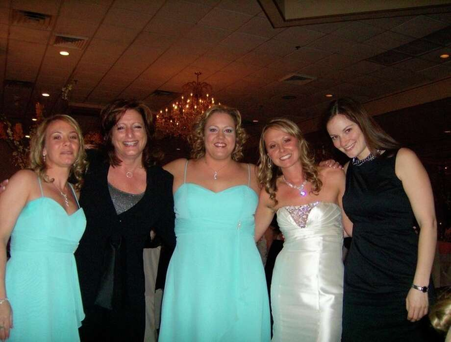 Carla Mortelliti (second from left) with coworkers at a coworkers wedding in April