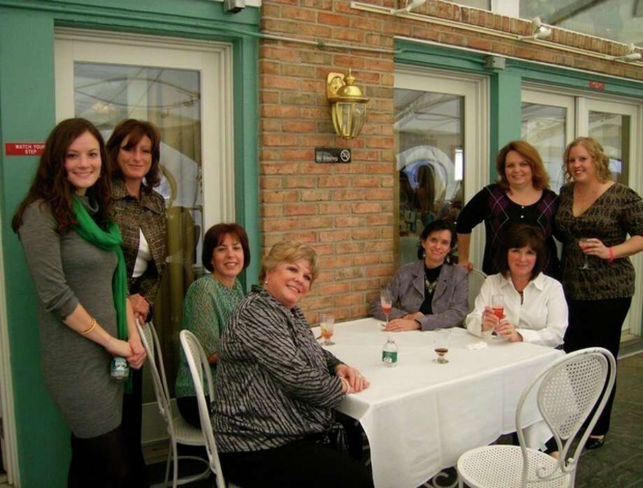 Carla Mortelliti (second from left), in November 2010 with coworkers