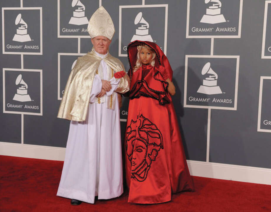 Nicki Minaj, right, and guest arrive at the 54th annual Grammy Awards on Sunday, Feb. 12, 2012 in Los Angeles. (AP Photo/Chris Pizzello) / AP