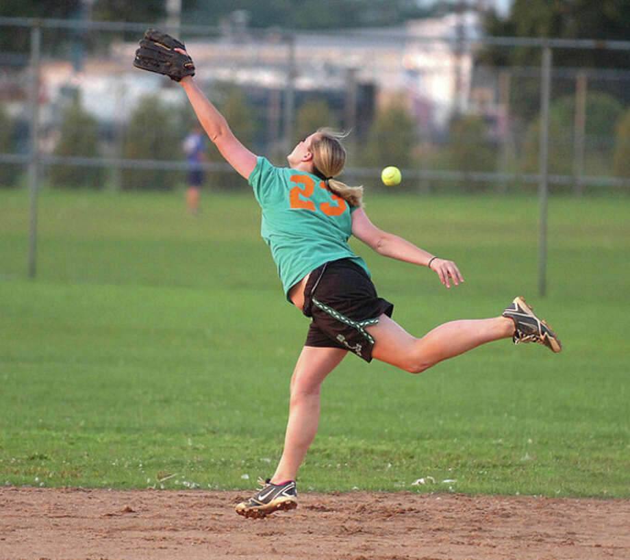 @White=[C] Hour photo/Alex von Kleydorff Breanne Morschauser of O'Neill's tries to make a running catch during Thursday's Norwalk Rec women's softball game against Elite Limo. O'Neill's scored a 10-2 victory. / 2011 The Hour Newspapers