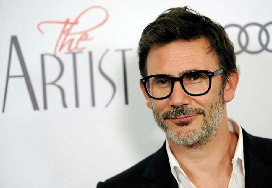 """FILE - In this Nov. 21, 2011 file photo, Michel Hazanavicius, writer/director of """"The Artist,"""" poses at a screening of the film in Beverly Hills, Calif. Hazanavicius was nominated Tuesday, Jan. 24, 2012 for an Academy Award for best director for the film. The Oscars will be presented Feb. 26 at the Kodak Theatre in Los Angeles, hosted by Billy Crystal and broadcast live on ABC. (AP Photo/Chris Pizzello, file) / AP"""
