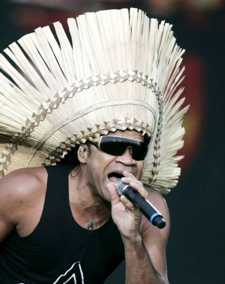 """FILE - In this Saturday June 28, 2008 file photo, Brazilian singer Carlinhos Brown performs during a concert on the main stage of the Rock in Rio music festival in Arganda del Rey on the outskirts of Madrid, Spain. Brown, along with Sergio Mendes and Siedah Garrett, were nominated Tuesday Jan. 24, 2012 for an Academy Award for music original song for """"Real in Rio"""" from the animated film """"Rio."""" The Oscars will be presented Feb. 26 at the Kodak Theatre in Los Angeles, hosted by Billy Crystal and broadcast live on ABC. (AP Photo/Paul White, File)"""