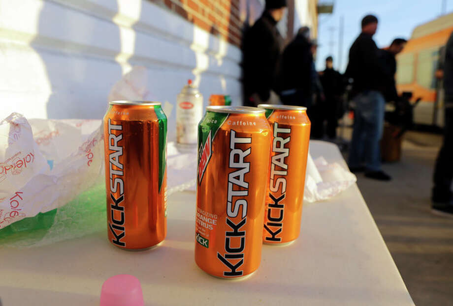 Product cans are on display during the filming of a commercial for a new PepsiCo product called Kickstart, a carbonated drink that is part juice with Mountain Dew flavor, on the streets of downtown Los Angeles Tuesday, Jan. 29, 2013. PepsiCo Inc. is set to roll out the new drink called Kickstart this month that has Mountain Dew flavor but is made with 5 percent juice and an extra jolt of caffeine and Vitamins B and C. The company is hoping to grow sales by reaching Mountain Dew fans at a new time of day: morning. (AP Photo/Reed Saxon) / AP