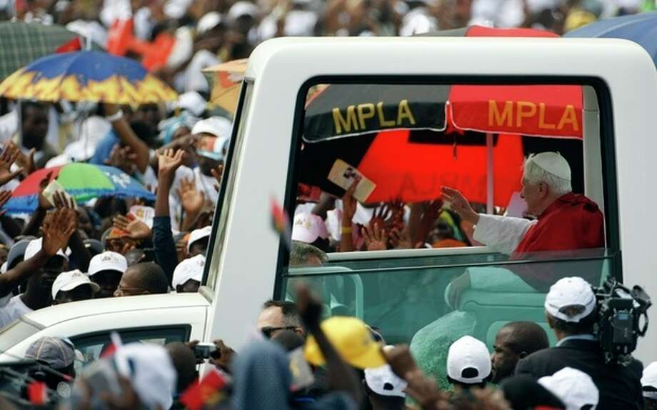FILE - In this Sunday, March 22, 2009 file photo, Pope Benedict XVI arrives in the popemobile to celebrate a Mass on the outskirts of Angola's seaside capital, Luanda, the last major event before the end of the visit on the following day. Pope Benedict XVI announced Monday, Feb. 11, 2013, he would resign Feb. 28 because he is simply too old to carry on. (AP Photo/Andrew Medichini, File) / AP