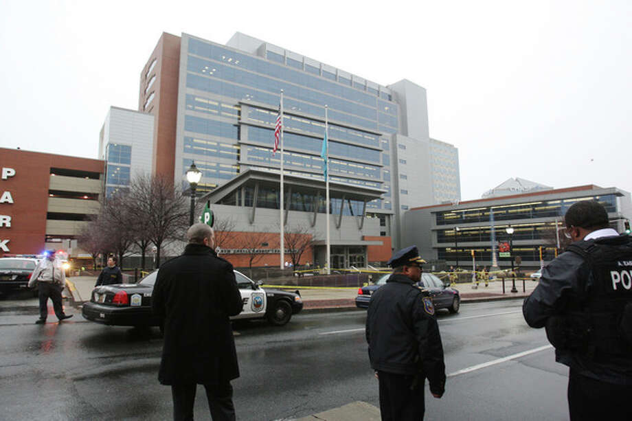 Police stand outside the New Castle County Courthouse, Monday morning, Feb. 11, 2013 in WIlmington, Del. , after a man killed his estranged wife and two others at teh courthouse. The mayofro f Wilmington says police have killed the gunman. (AP Photo/The News Journal/William Bretzger) PHILADELPHIA TV OUT AND PHILADELPHIA ONLINE SITES OUT /  Wilmington News-Journal