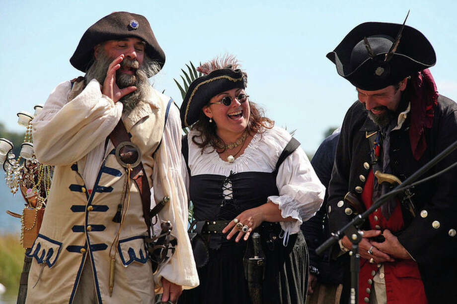 The Buccaneers sing pirate songs to an audience at the Oyster Festival in Norwalk in 2010. Hour Photo / Danielle Robinson