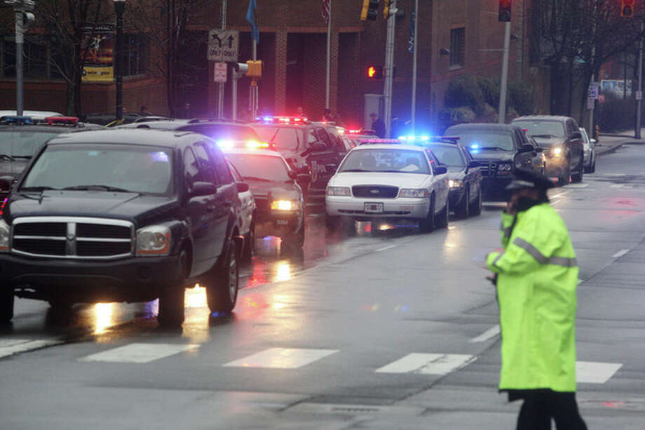 Police cars fill the street outside the New Castle County Courthouse, Monday morning, Feb. 11, 2013 in WiIlmington, Del. , after a man killed his estranged wife and two others at the courthouse. The mayor of Wilmington says police have killed the gunman. (AP Photo/The News Journal/William Bretzger) PHILADELPHIA TV OUT AND PHILADELPHIA ONLINE SITES OUT /  Wilmington News-Journal