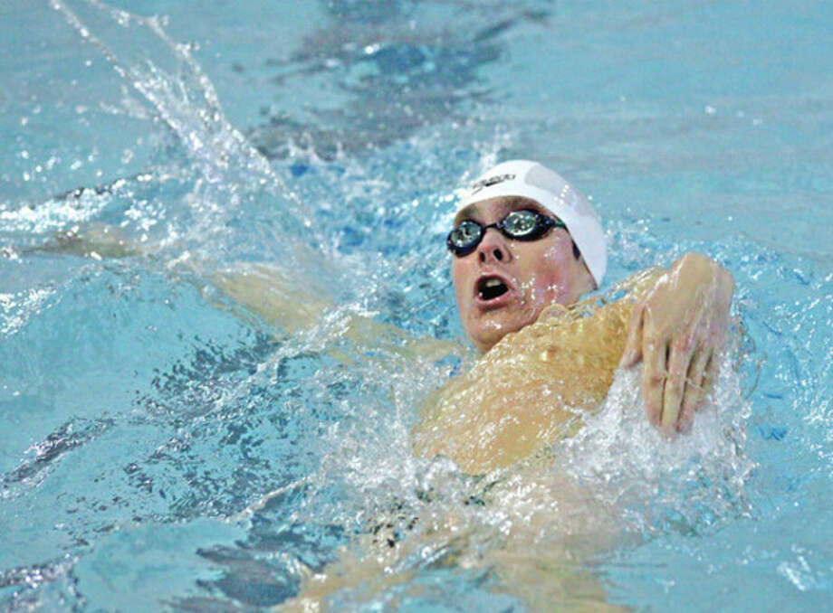 Hour photo/Danielle Robinson Norwalk's Jake St. John swims the backstroke during Tursday's meet against Trumbull at NHS's Spinola Natatorium. The Bears won nine of the 12 events contested at the meet, but couldn't match Trumbull's depth. The Eagles took a 97-85 victory.