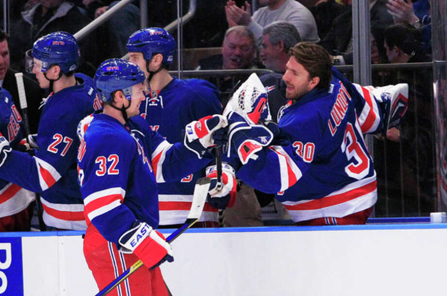 New York Rangers' Anton Stralman (32) celebrates his first goal of the season with goalie Henrik Lundqvist (30) during the first period of an NHL hockey game Thursday, Jan. 5, 2012, in New York. (AP Photo/Frank Franklin II) / AP