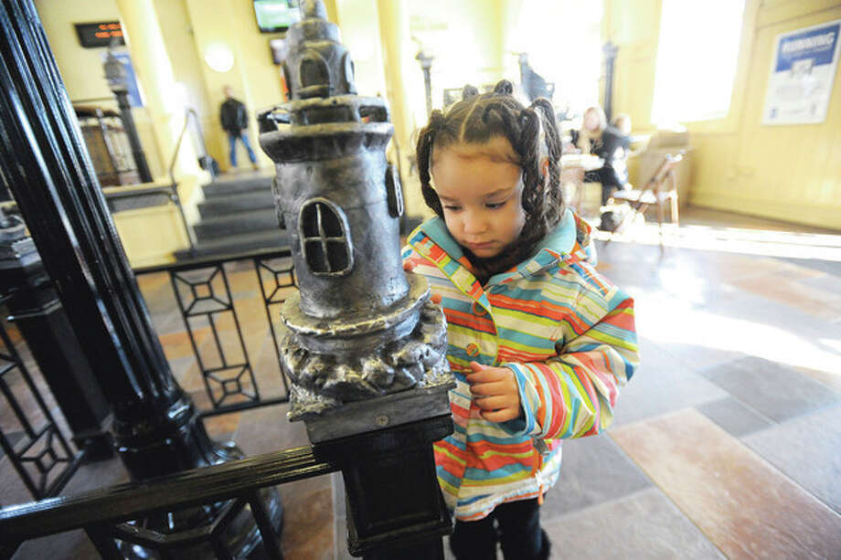 Saliyah Cordero 4, looking at some of the new art that is installed at the South Norwalk train station while her family waits for the train on Monday morning. hour photo/Matthew Vinci / (C)2011, The Hour Newspapers, all rights reserved
