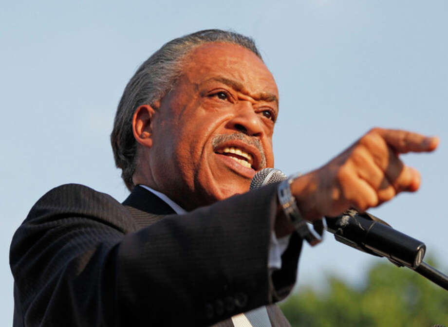 Al Sharpton speaks at a local NAACP rally in support of Tonya McDowell held at Brookside School in Norwalk Tuesday evening.