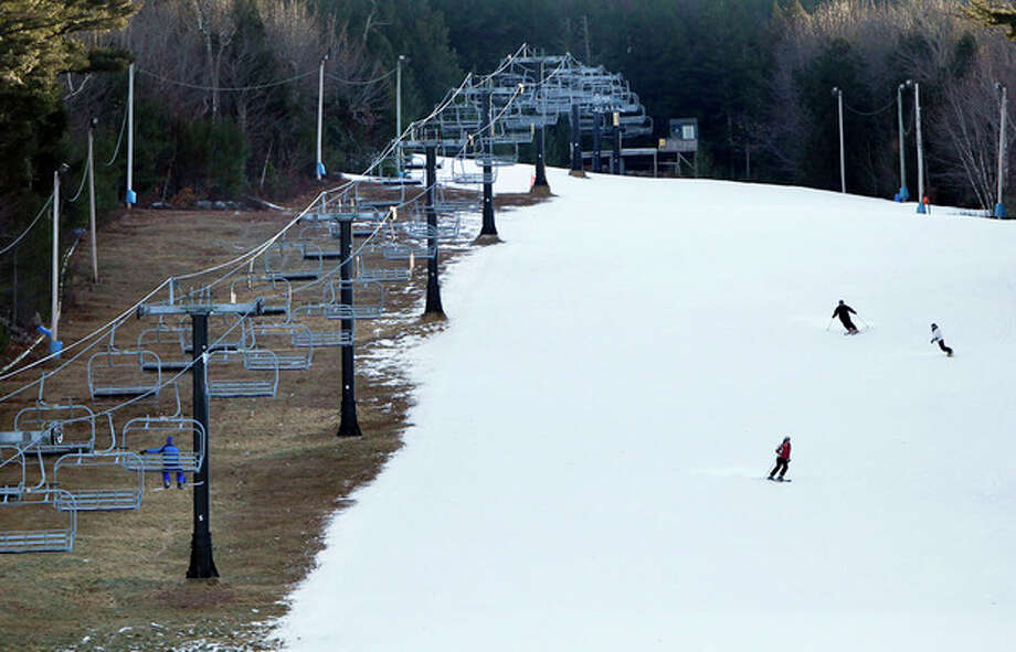 Man-made snow coats a ski run but barren ground remains under a chairlift at Shawnee Peak ski area, Thursday, Jan. 5, 2012, in Bridgton, Maine. Across much of the Northeast most natural snow has either melted or been washed away by rain. (AP Photo/Robert F. Bukaty) / AP