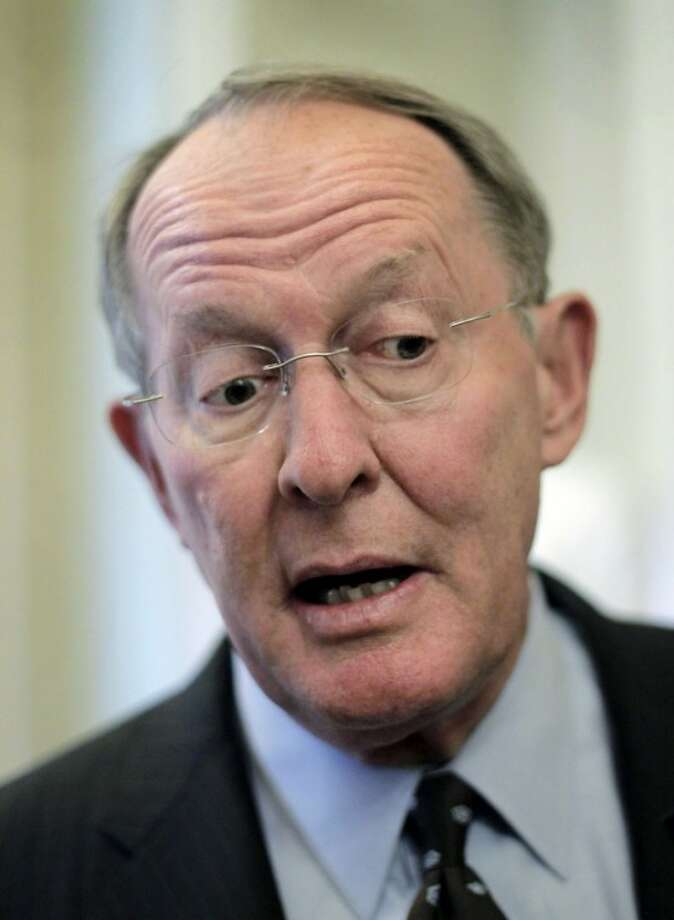 "FILE - In this Sept. 20, 2011, file photo Sen. Lamar Alexander, R-Tenn., the number three Republican in the Senate, talks about his decision to step down from his leadership post on Capitol Hill in Washington. A former education secretary, Alexander said he's hopeful Congress will do what's right and update No Child Left Behind, which became due for renewal in 2007. ""What we ought to do is set new realistic goals for it so that schools and schools can have those kinds of goals, and most importantly we need to move out of Washington and back to states and local communities decisions about whether schools and teachers are succeeding or failing."" (AP Photo/J. Scott Applewhite, File)"