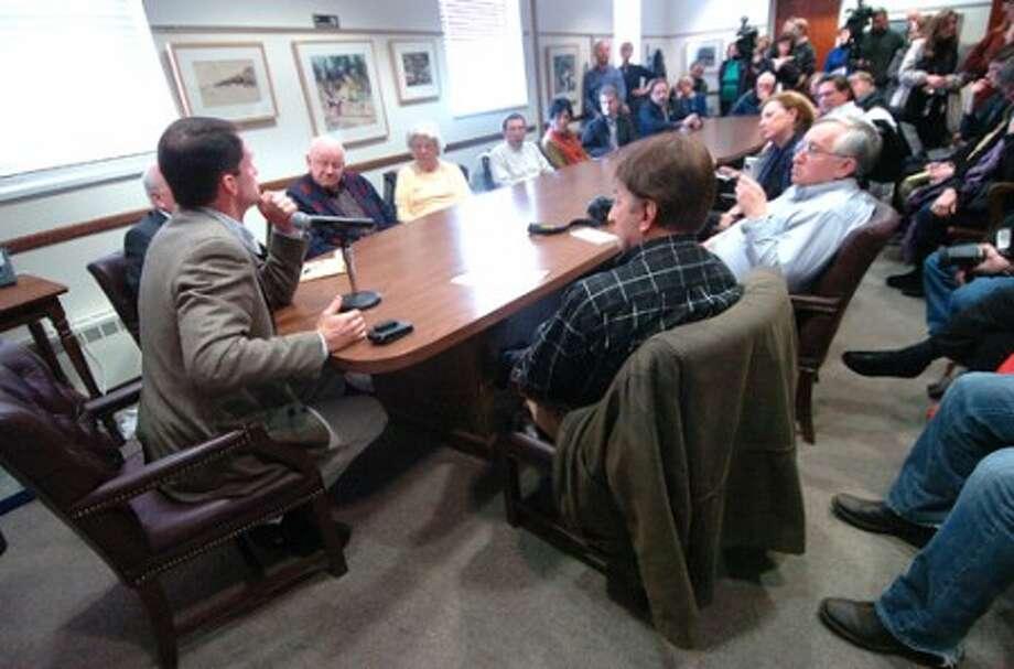 Photo/Alex von Kleydorff. Jim Himers speaks to a crowded meeting room at Westport Town Hall.